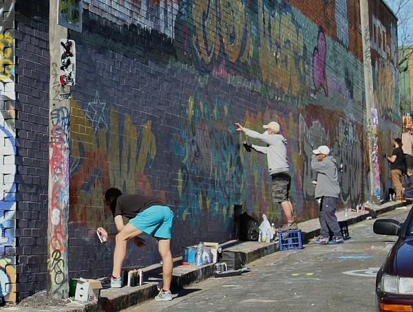 Graffiti artists at work in enmore