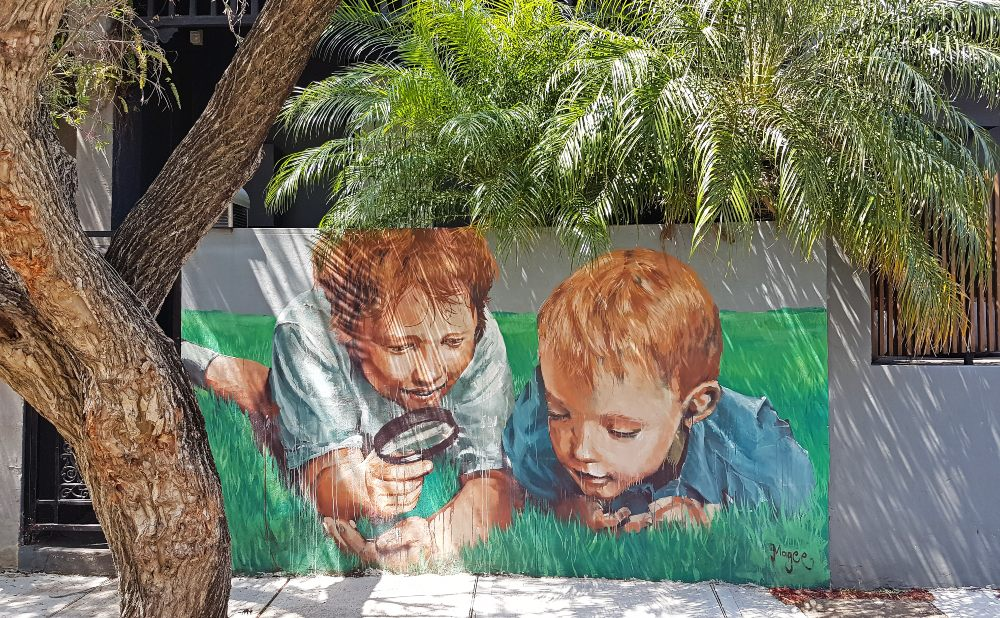 Fintan Magee Enmore 2 little boys with magnifying glass