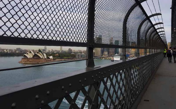 Walking across teh Sydney Harbour bridge footpath
