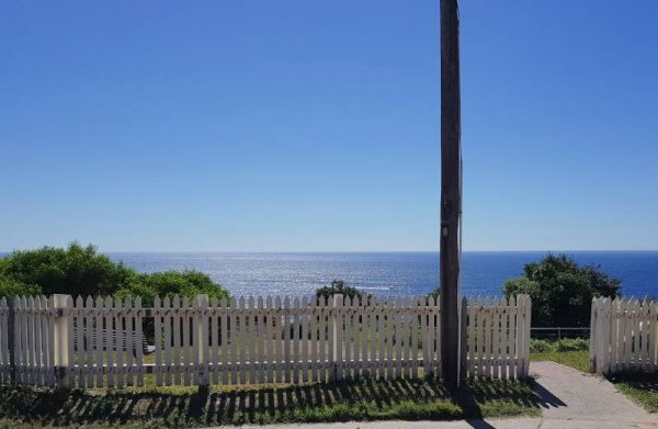 start the walk to Watsons Bay at this white picket fence
