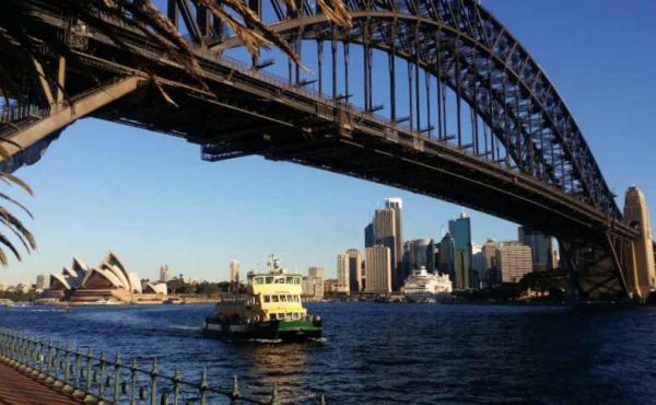 ferry travelling under Sydney Harbour Bridge