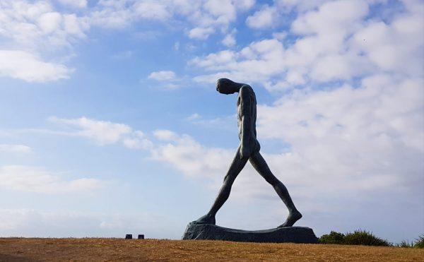 large man sculpture by the sea bondi