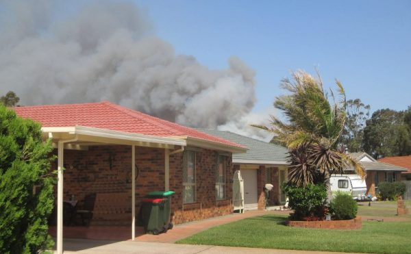 homes in Forster threatened by fire