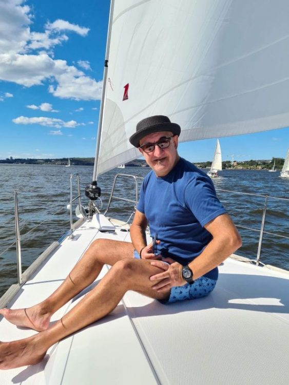 Charles on the bow of Sydney Harbour Yacht Stay