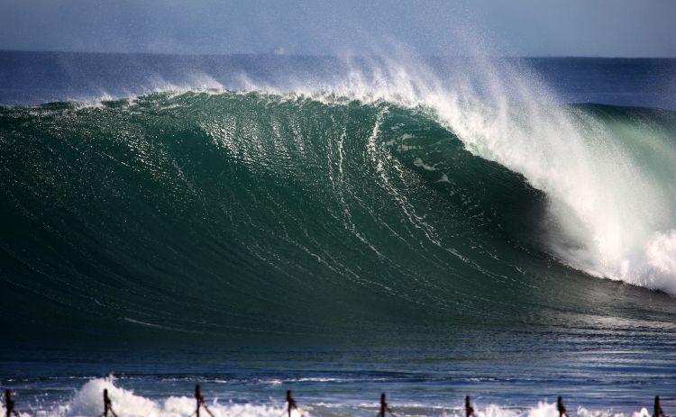 A giant wave breaks towards the shore at Newcastle Beachs Austrailia